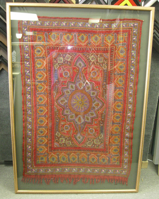 Framed antique rug