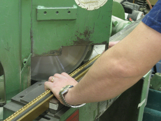 Cutting material for a picture frame